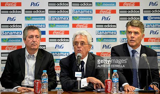 Mexican Football Federation president Justino Compean flanked by the owner of Mexican football club Chivas Jorge Vergara and the director of the...