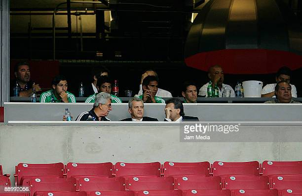 Mexican Football Federation president Justino Compean, national team coach Javier Aguirre and the team's director Nestor de La Torre talk during a...