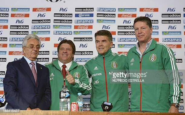 Mexican Football Federation president Justino Compean newlyassigned Mexican national football team head coach Miguel Herrera and Memxican Football...