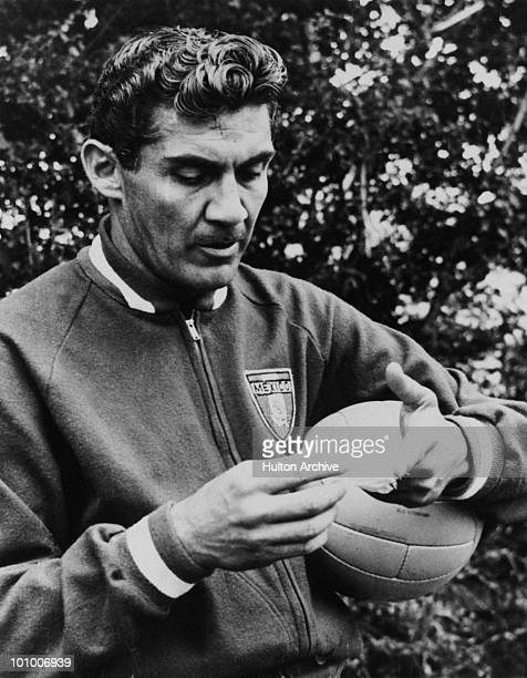 Mexican footballer Antonio Carbajal shows his bandaged hand during a training session in Hertfordshire shortly before a World Cup match against...