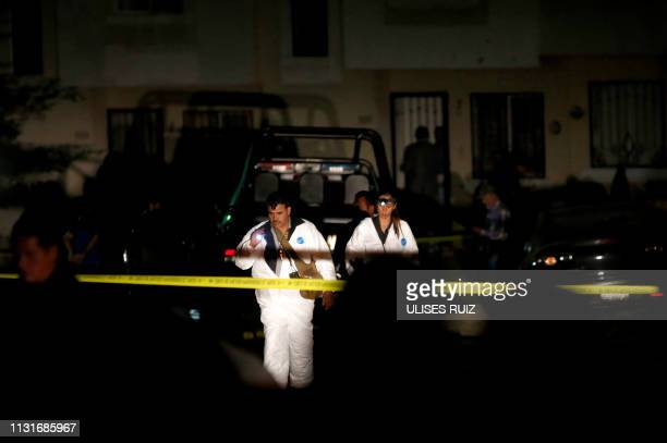 Mexican forensic staff work at the place where the Guadalajara's police commander Sergio Rivas Mejia and one of his escorts where murdered after...