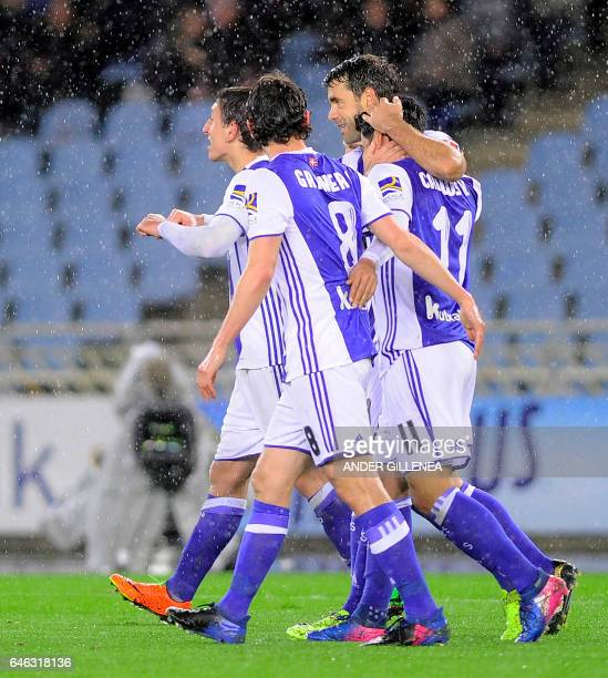 Mexican forward Carlos Vela celebrates a goal with teammates during the Spanish league football match Real Sociedad vs SD Eibar at the Anoeta stadium...