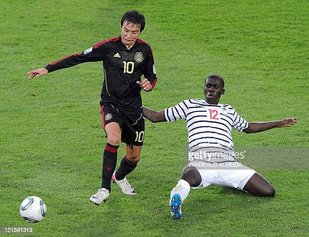 Mexican forward Erick Torres is marked by French defender Kalidou Koulibaly during the FIFA 2011 Under-20 World Cup third place football match in...