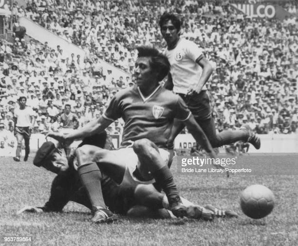 A Mexican forward land on top of El Salvador goalkeeper Raúl Magaña during a World Cup Group 1 match against Mexico at the Estadio Azteca in Mexico...