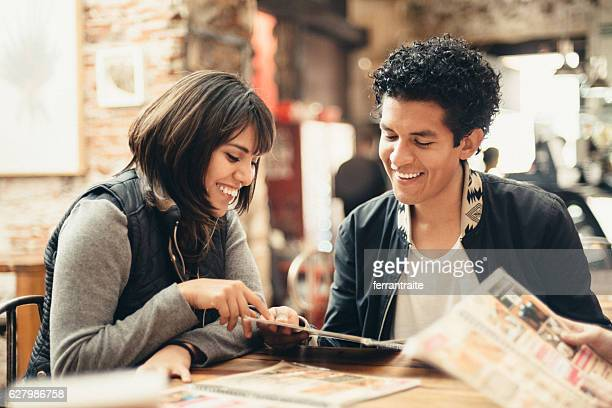 mexican friends hanging out in coffeeshop - menu stock pictures, royalty-free photos & images