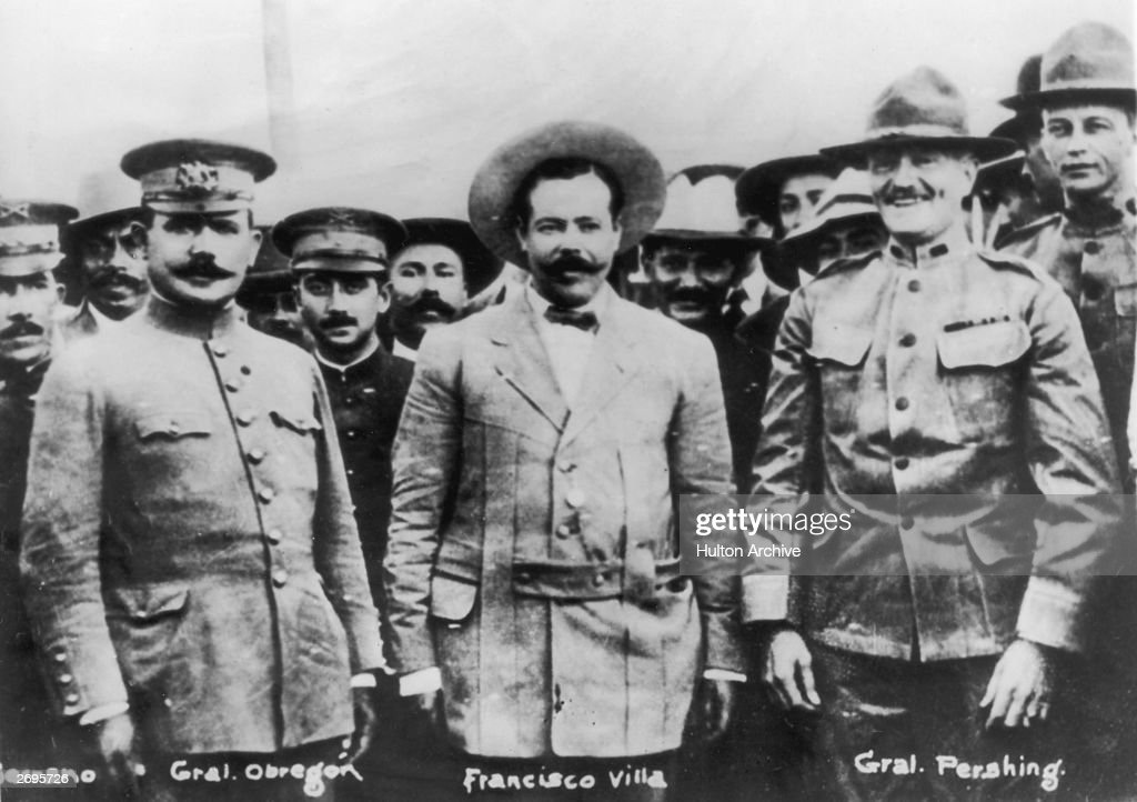 Mexican general Alvaro Obregon (1880 - 1928), Mexican revolutionary Francisco (Pancho) Villa (1877 - 1923), and American general John Pershing (1860 - 1948) pose for a photo with other military officers, circa 1915.