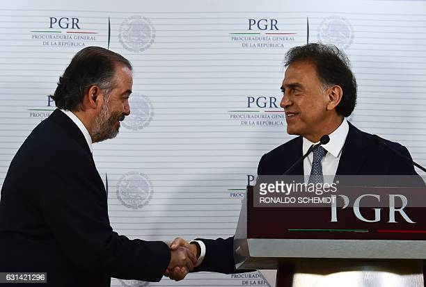 Mexican General Attorney Raul Cervantes shakes hand with Veracruz´ governor Miguel Yunez during a press conference about Veracruz state former...
