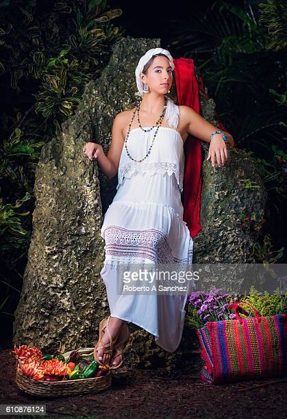 Mexican girl with flowers and fruits