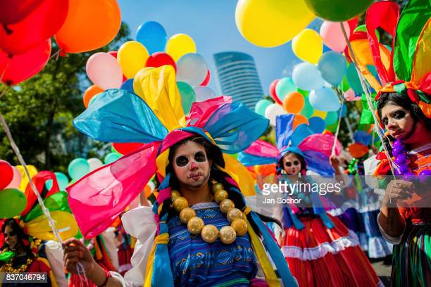 Mexican girls wearing costumes walk in the street during the Day of the Dead festival on October 29 2016 in Mexico City Mexico Day of the Dead is a...