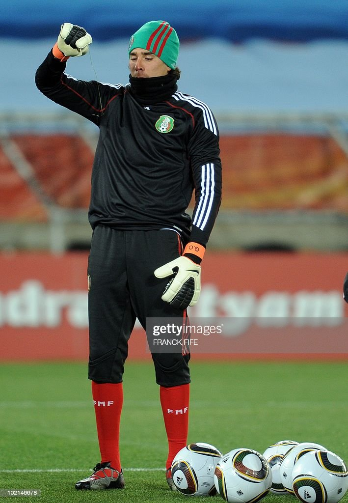 Mexican goalkeeper Guillermo Ochoa looks at the piece of cable found in the field of Peter Mokaba stadium in Polokwane during a training session on June 16, 2010. Mexico will face France next June 17 in their Group A game of the World Cup 2010 in Polokwane.