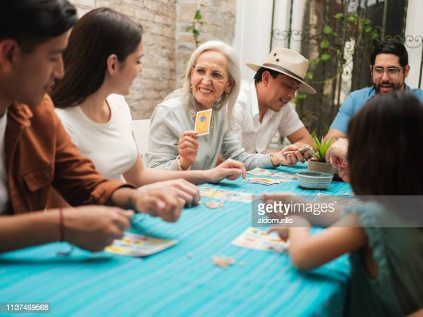 a mexican grandmother playing a traditional mexican game - game night leisure activity stock pictures, royalty-free photos & images