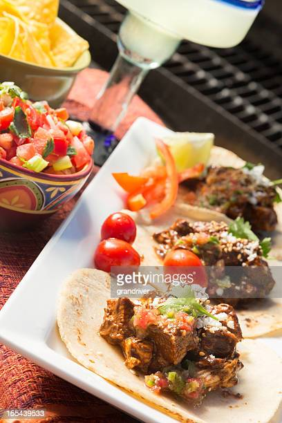 mexican grilled chicken tacos, margarita and fire - mole sauce stock pictures, royalty-free photos & images
