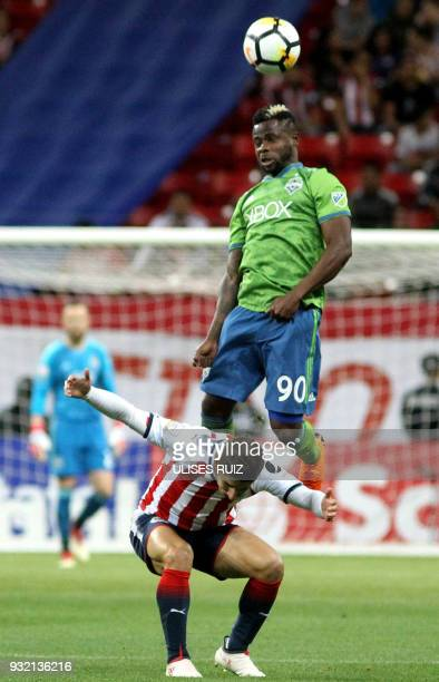 Mexican Guadalajara's midfielder Isaac Brizuela vies for the ball with US Seattle Sounders defender Waylon Francis during their second leg match of...