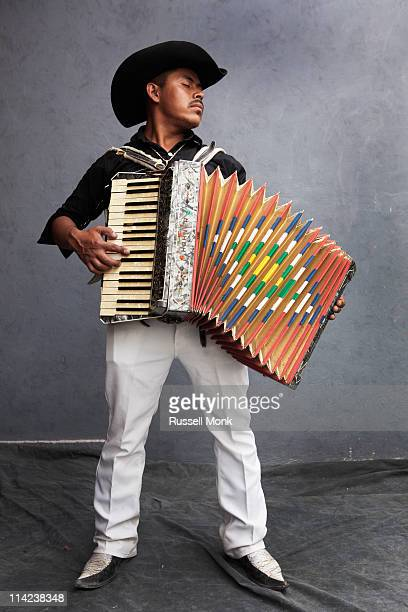 Mexican guy playing the accordion