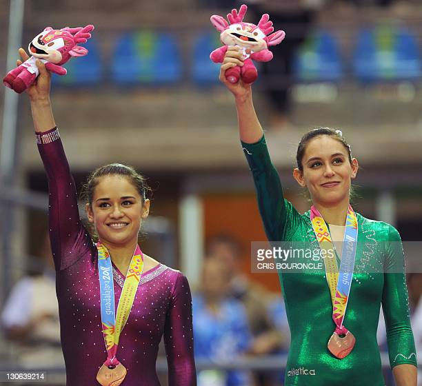 Mexican gymnasts Elsa Garcia and Marisela Cantu stand at the podium after winning bronze medals with tied scores for the artistic gymnastics uneven...