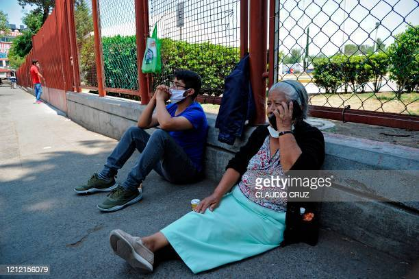 Mexican Helia Solis , relative of a patient, speaks on a mobile phone outside the Belisario Dominguez Hospital in Mexico City, on May 05 amid the new...