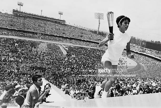 Mexican hurdler Enriqueta Basilio carries the Olympic torch to the cauldron during the opening ceremony of the 1968 Summer Olympics in Mexico City...
