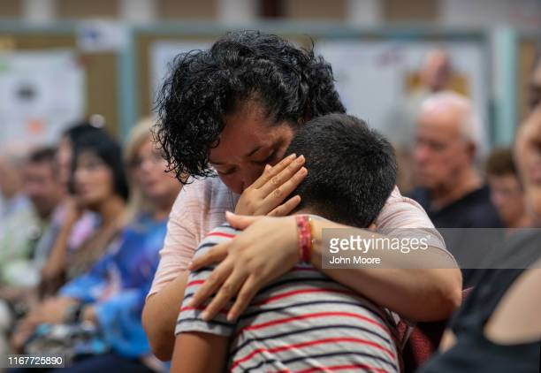 Mexican immigrant embraces her son at town hallstyle event held to reassure the nervous local immigrant community on August 12 2019 in Stamford...
