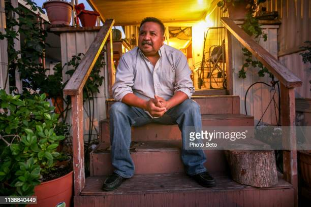 a mexican immigrant in front of his home in san bernardino in southern california - mid adult men stock pictures, royalty-free photos & images