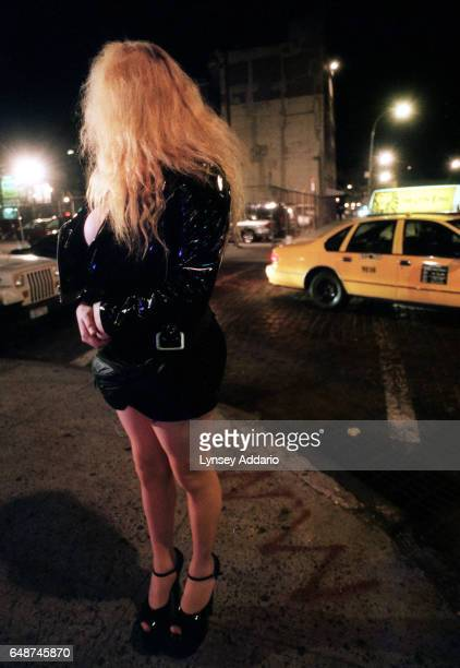 Mexican immigrant transgendered prostitute stands on a street corner in the West Village of New York City in 1999