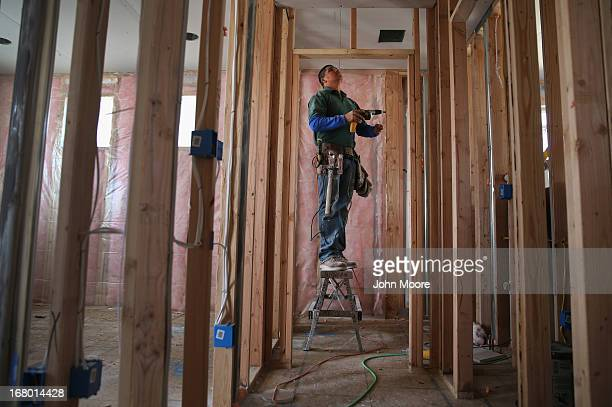 Mexican immigrant works on a housing development on May 3 2013 in Denver Colorado The resurgent housing market has helped drive down unemployment...