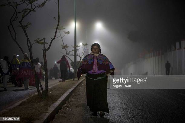 Mexican indigenous walks at the outskirt of the stage before the mass of Pope Francis on February 15 2016 in San Cristobal de las Casas Mexico