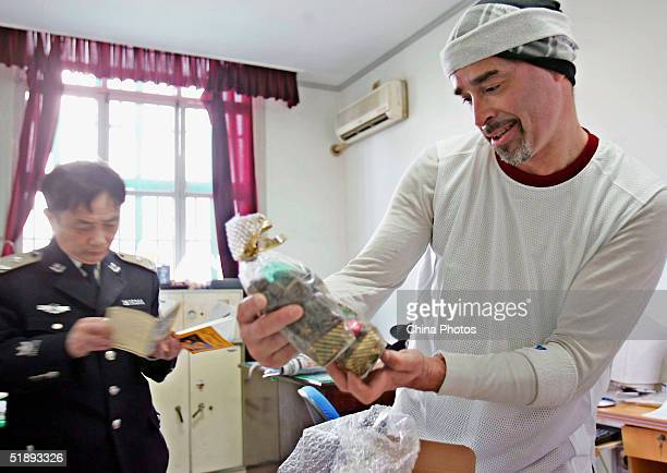 A Mexican inmate gets Christmas gifts sent by his family at the Shanghai Qingpu Prison on December 24 2004 in Shanghai China As the only local prison...