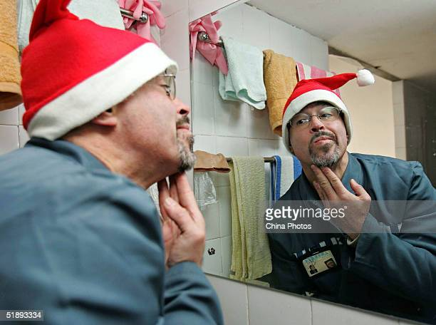 A Mexican inmate of the Shanghai Qingpu Prison spruces himself before an evening held by the prison to celebrate Christmas on December 24 2004 in...