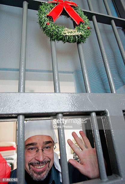 A Mexican inmate of the Shanghai Qingpu Prison waves during an evening held by the prison to celebrate Christmas on December 24 2004 in Shanghai...