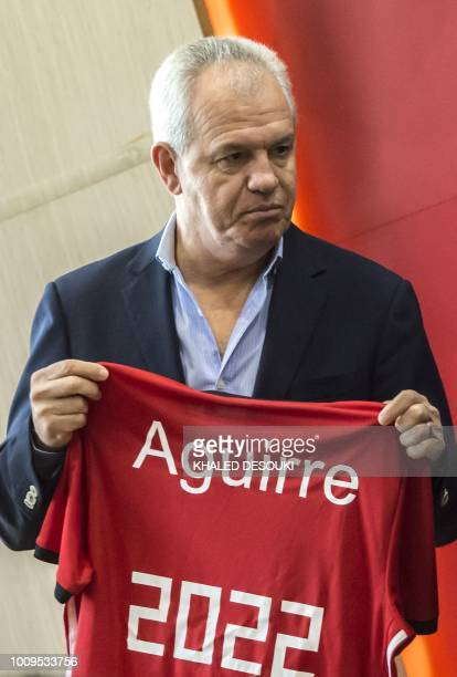 Mexican Javier Aguirre holds the jersey of Egypts national team during a press conference in the capital Cairo on August 2 2018 The Egyptian Football...