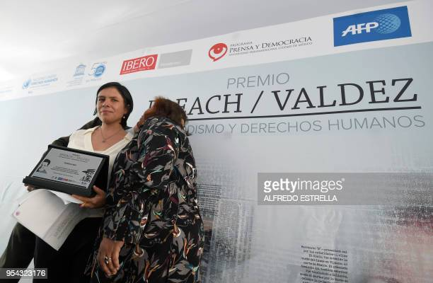 Mexican journalist Daniela Rea receives the BreachValdez Prize in Journalism and Human Rights next to Mexican journalist Jose Reveles and the widow...