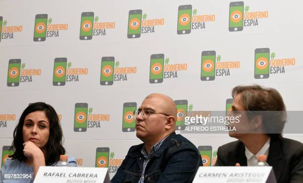 Mexican journalists Ana Cristina Ruelas Rafael Cabrera and Carmen Aristegui take part in a press conference in Mexico City on June 19 on an article...
