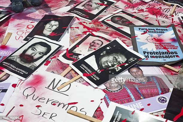 Mexican journalists protest against violence towards journalists in Mexico placing on the ground pictures of murdered journalists on August 7 2010 in...