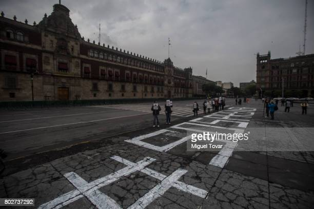 Mexican journalists protest the murder of reporter Salvador Adame outside the Palacio Nacional on June 28 2017 in Mexico City Mexico The burnt...
