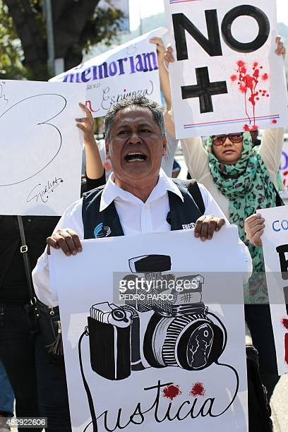 Mexican journalists take part a demonstration protesting for the murder of photojournalist Ruben Espinosa in Acapulco Guerrero state Mexico on August...
