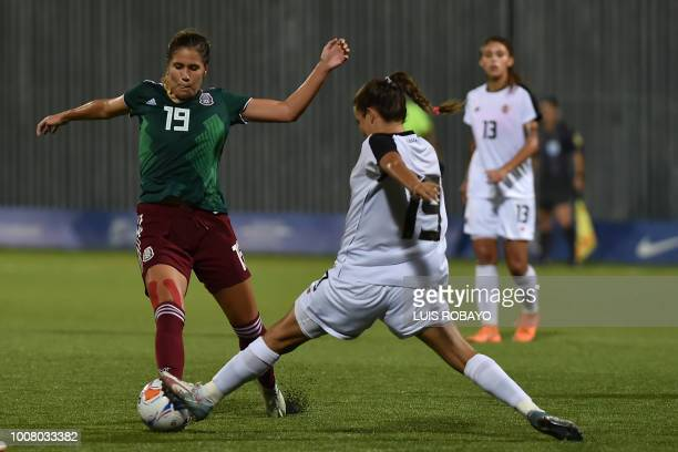 Mexican Katlin Johnson is marked by Costa Rican Fabila Sanchez during their women's football gold medal match of the 2018 Central American and...