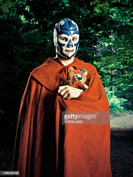 mexican lucha libre fighter with stuffed toy - wrestling stock pictures, royalty-free photos & images