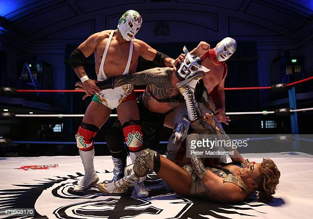 Mexican Lucha Libre wrestlers Dr Wagner JR, Cassandro and El Hijo Del Santo pose at York Hall with Lucha Britannia's Metallico on July 8, 2015 in...