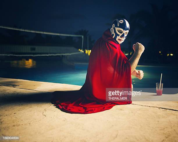 mexican luchador by the pool