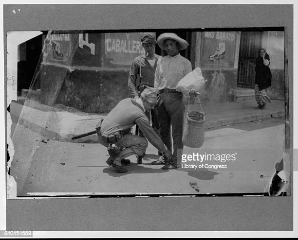 A Mexican man is searched in a street by soldiers from the United States Navy during the occupation of Veracruz The United States invaded Veracruz in...