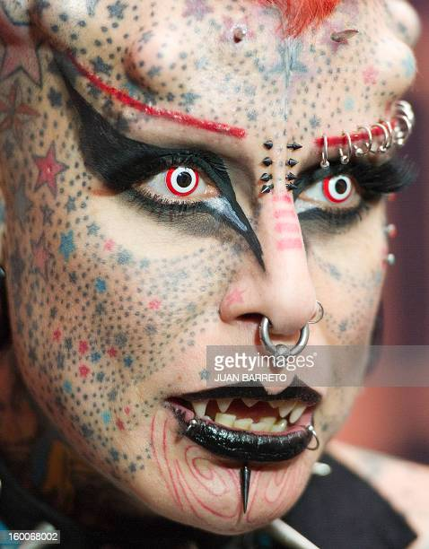 "Mexican María Jose Cristerna ""The Vampire Woman"" poses during the Expotattoo Venezuela 2013 in Caracas on January 25 2013 The event will be held in..."