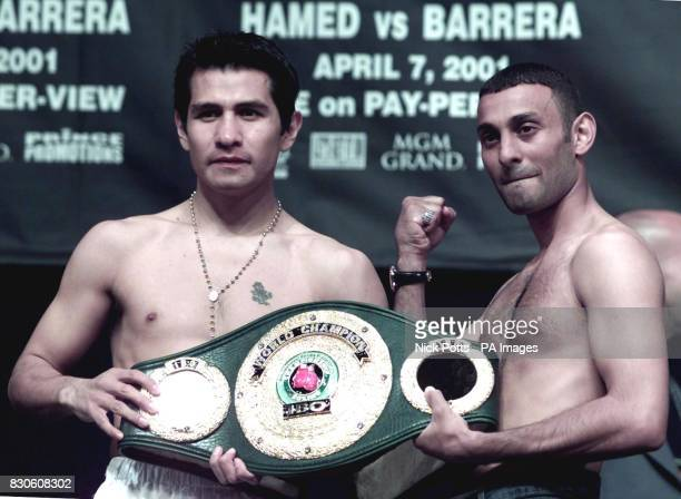Mexican Marco Antonia Barrera holds the IBO Featherweight belt with British boxer Prince Naseem Hamed during the weighin ahead of the title fight on...