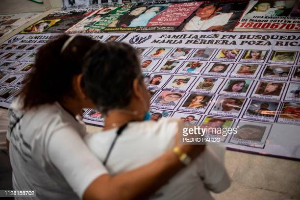 Mexican Maria Herrera who looks for four missing sons looks at portraits during a mass as part of the activities of the fourth National Search...