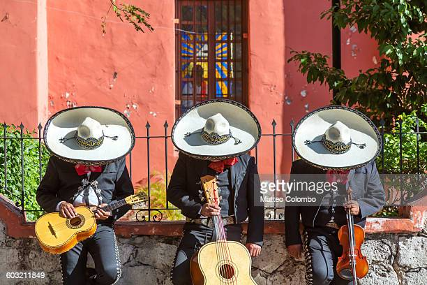 mexican mariachi group doing a siesta, mexico - mexico stock photos and pictures