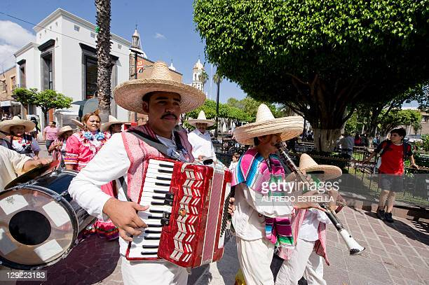 Mexican mariachi musicians play during the arrival of the torch of the PanAmerican Games at Tlaquepaque state of Jalisco Mexico on October 14 2011...