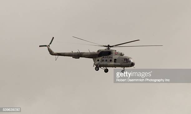 A Mexican Marine military helicopter patrols the Rio Grande River over the US border with Brownsville Texas on Friday afternoon following reports of...