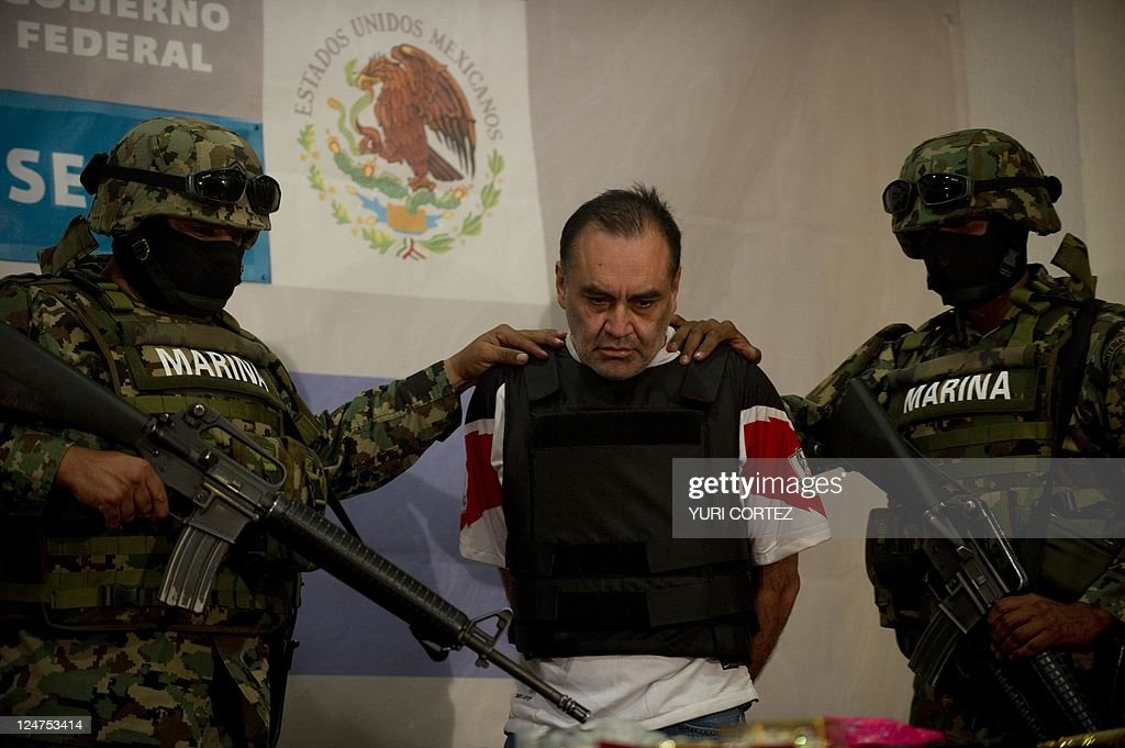 Mexican marines escort alleged financial agent of the drug