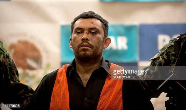 Mexican marines escort Marcos Jesus Hernandez Rodriguez aka El Chilango alleged leader of assassins and member of the Los Zetas drug cartel in...