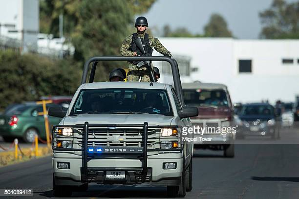 Mexican marines patrol outside the Navy hangar awaiting the arrival of Joaquin 'El Chapo' Guzman the most wanted drug lord on January 08, 2016 in...