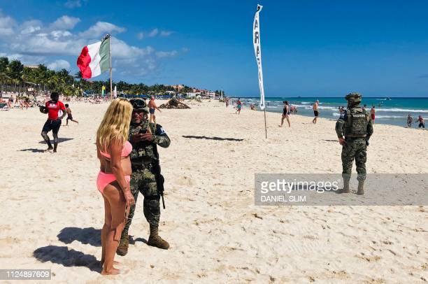 Mexican marines patrol the beach of Playacar near the seaside tourist resort of Playa del Carmen Quintana Roo State on February 14 2019 Playa del...